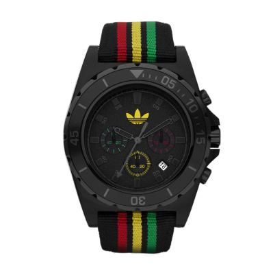 Chronograph analogical quartz movement.  Black policarbonate case. Black fabric strap with red, yellow and green stripes.  Black  dial with calendar.  http://www.watchrepublic.co.za