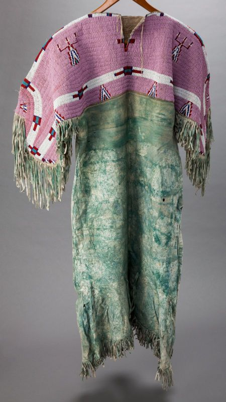 A SIOUX BEADED HIDE DRESS. c. 1900. Back side.