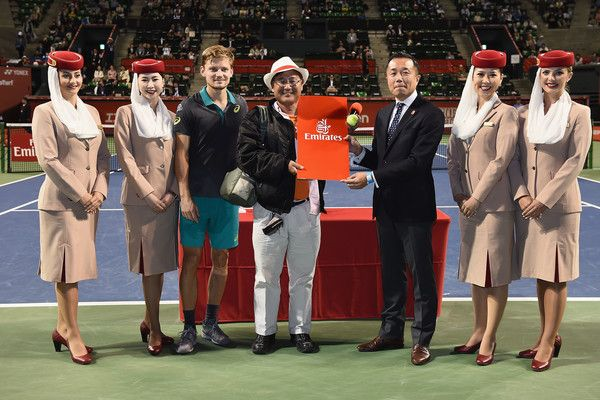 David Goffin Photos - David Goffin of Belgium poses with competition winner after his quarterfinal match against Richard Gasquet of France during day five of the Rakuten Open at Ariake Coliseum on October 6, 2017 in Tokyo, Japan. - Rakuten Japan Open - Day 5
