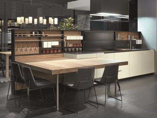 "Varenna_PHOENIX #1 Peninsula top in solid walnut canaletto. Equipped back Shaker with carbone embossed lacquered structure, back in solid walnut canaletto, integrated Vertigo hood. Worktop depth 29 1/2"" in micro-blasted nero sand composite stone."
