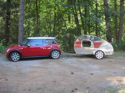 MiniTears.  Tear drop trailers (originally found at Vacations In A Can) designed especially for minis and other small cars.