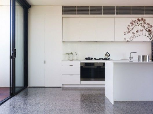 © Derek Swalwell. Polished concrete floor, white kitchen