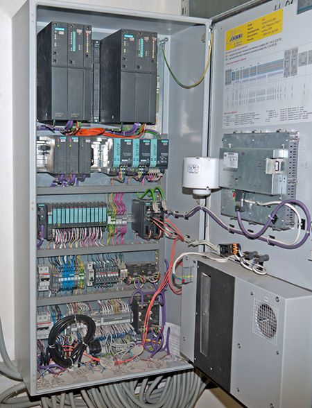 Programmable Logic Controller (PLC) performing local control functions, physically separated, but wired to a nearby Remote Terminal Unit (RTU)