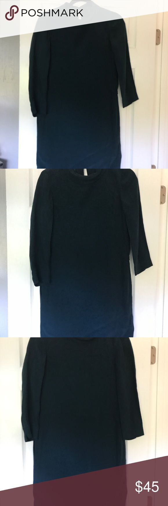 Like new classy work dress Perfect for work, classy, arms go just belong elbows, beautiful dark green color, button in back, high neck, loose fit Massimo Dutti Dresses Midi