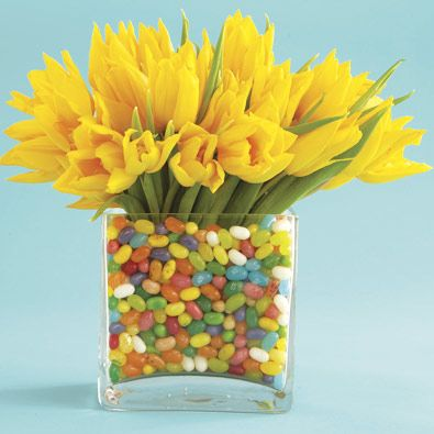 Fill a transparent vase with some jelly beans and then arrange some