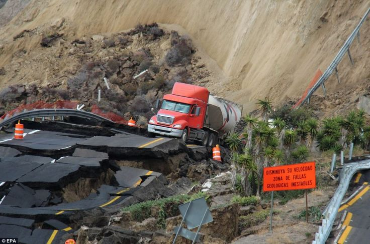 Cliff-side cracks: A cement truck driver was rescued from his vehicle after huge section of the Tijuana-Ensenada toll road cracked and slid ...