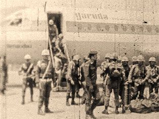 Arrival of indonesian troops on a Garuda Indonesia air company plane. (circa.1975).