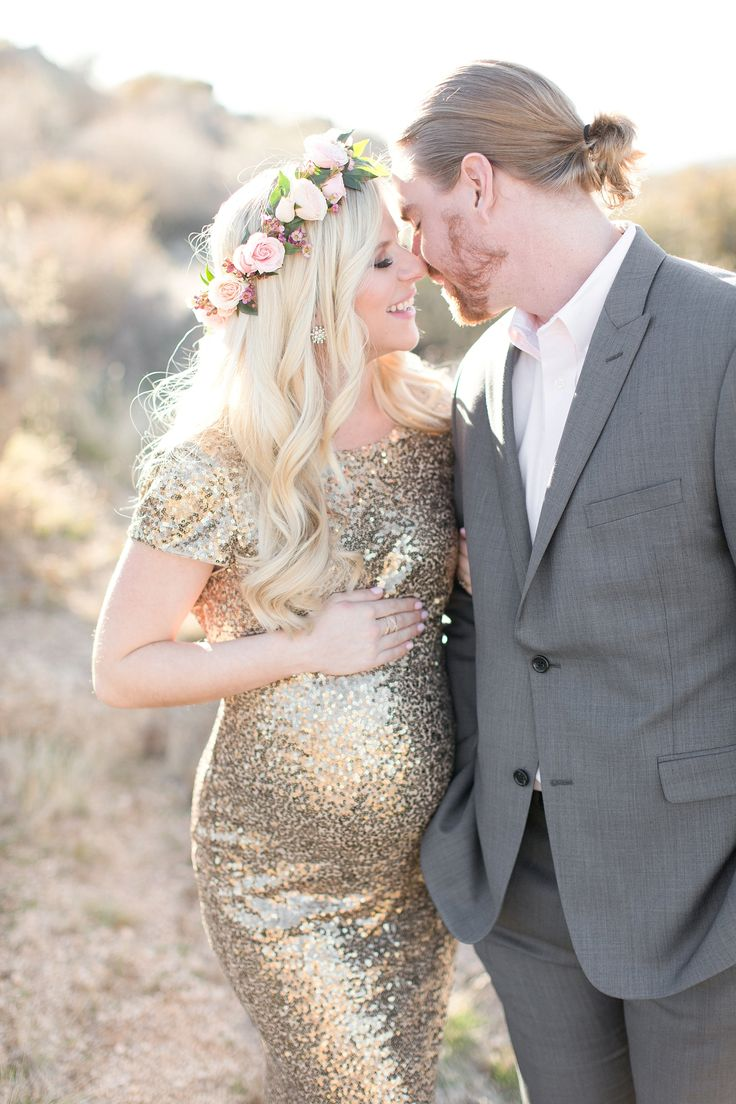 Gorgeous sunset desert maternity session. Blush rose floral crown. Gold sequined long gown for mamma to be. Light grey suit for expecting dad.