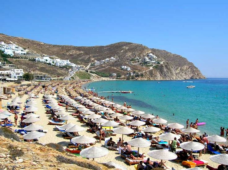 Elia beach is a beautiful and very popular beach in Mykonos, ideal when north winds blows, since is protected by the surrounding mountains. It is one of the largest beaches on the island, with shallow waters, fine golden sand and wonderful views at Naxos.
