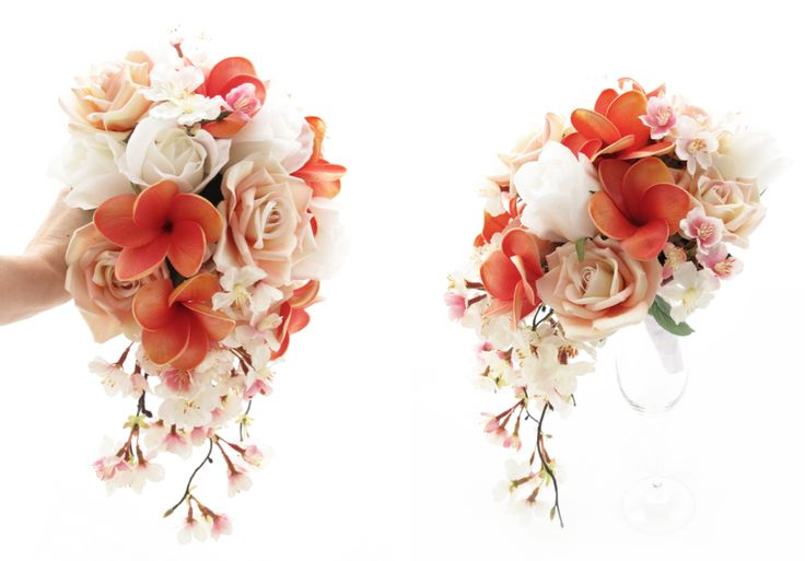 A small trail of coral frangipanis, cherry blossom, Fresh Touch large rosebuds and blush Classic roses. Find your perfect wedding flowers at https://www.loveflowers.com.au