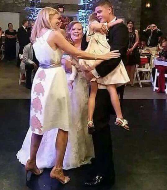 Tyler & Caitlin Wedding with their Daughters Carly & Nova with Theresa at their wedding