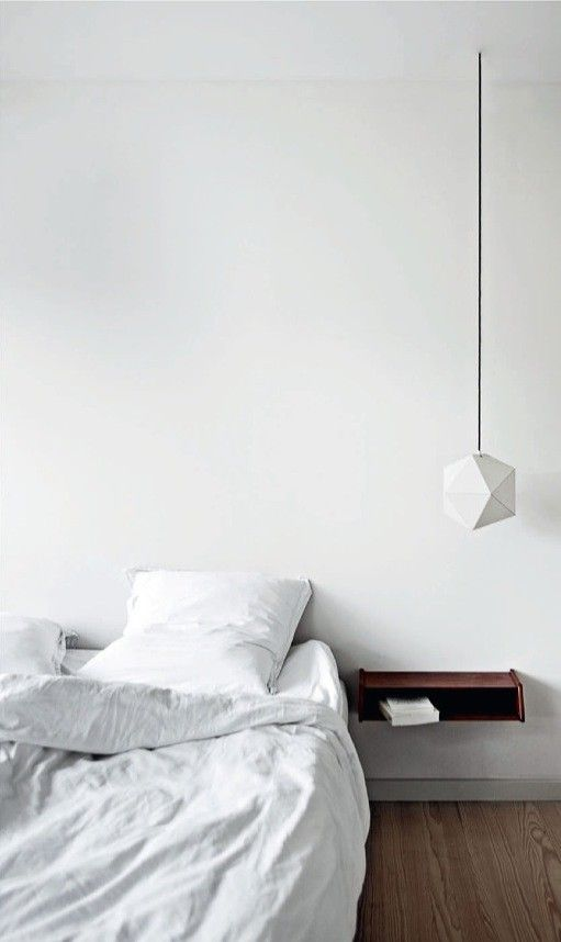 I may have repinned this before. I may again. [floating white bed floating dark shelf hanging geometric light]