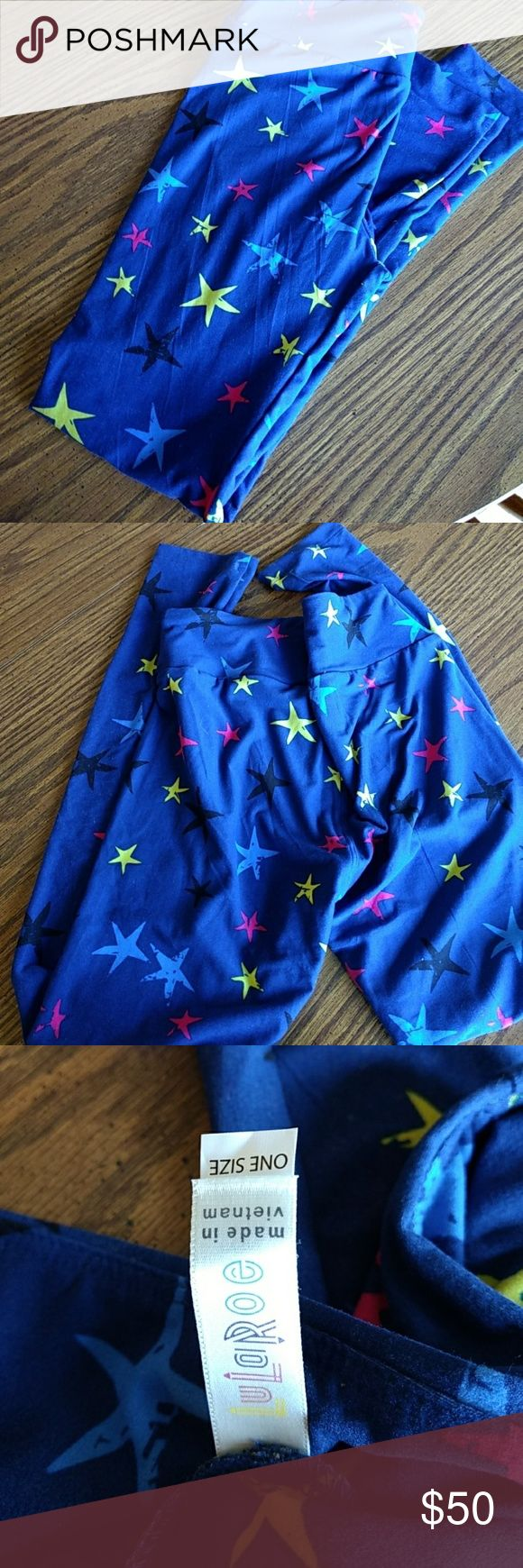 Lularoe STAR Leggings NWOT Royal blue with yellow, pink, black and light blue stars. Tag says One Size, but I would guess they're more like an 8. LuLaRoe Pants Leggings