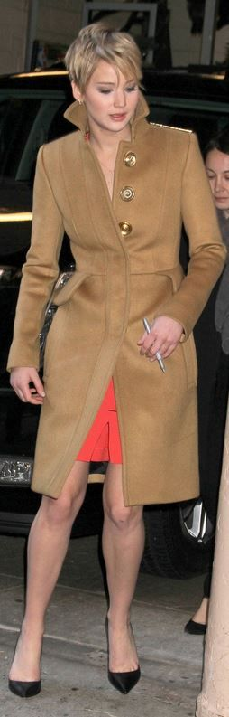 Jennifer Lawrence: Dress – Marios Schwab  Shoes – Sophia Webster  Jewelry – EF Collection  Coat – Burberry