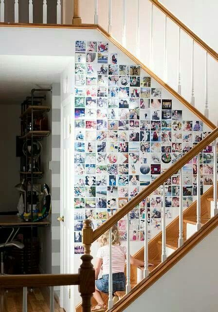 Wall photo collage - I would love to do this in my room with my slanted ceilings. This could be very fun.