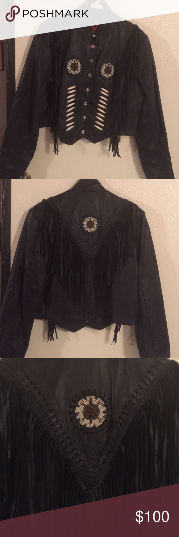 Ladies leather jacket New without tags. Never even tried on. Beautiful waist length black leather. Beadwork, braidwork  and fringe on front and back. Snap up front. Inside pocket. Nylon lining. hot leathers Jackets & Coats