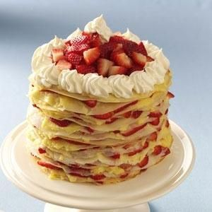Strawberry-Lemon Crepe Cake Recipe -Each year for my husband's birthday I make him a different lemon cake (a tradition started by his mother). A couple years ago I made a Lemon Crepe Cake and it was really good. This spring I added fresh strawberries and the cake was fabulous! I like to make the crepe batter and lemon curd the night before and assemble the next morning. —Lora Roth, Seneca, South Carolina