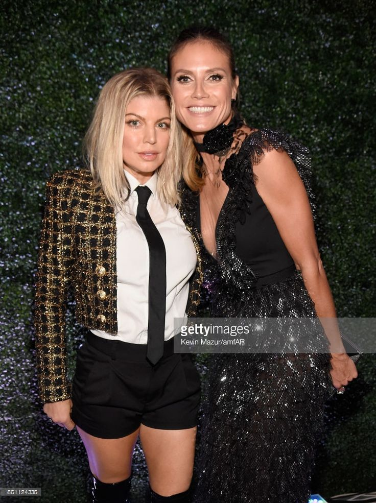 Singer Fergie (L) and tv personality Heidi Klum attend the amfAR Gala Los Angeles 2017 at Ron Burkle's Green Acres Estate on October 13, 2017 in Beverly Hills, California.