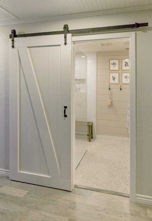 If I get to do a bathroom, this is the type of flooring I would like to do in our shower and floor. I like how the flooring is seamless and level with the shower. jenna-sue-blog-pebble-tile-bathroom-makeover