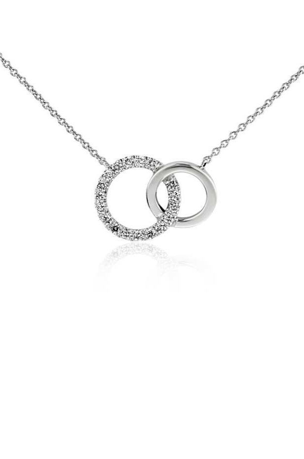 Irresistibly chic, this necklace is crafted with 14k white gold and features an interlinking double ring design with pavé-set diamonds.