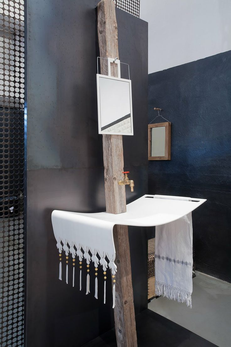 A washbasin that looks like an moroccan towel.