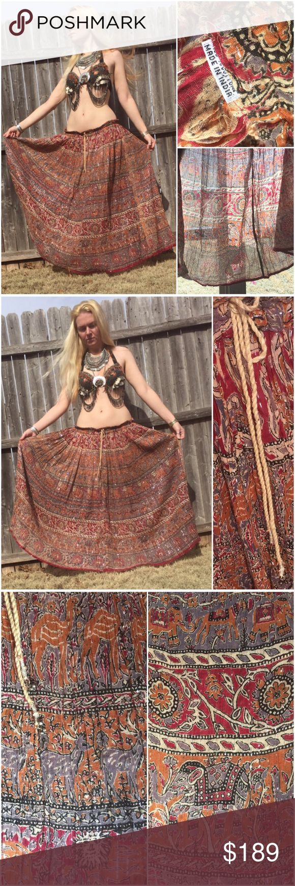 70s metallic gauze India Boho festival gypsy skirt Vintage 1970s metallic gauze India dress skirt. It has all kinds of different animals including peacocks , deer , elephants & sun gods. The skirt is covered with metallic threads giving a beautiful shimmery glittery glow! Size S-L adjustable rope belt with bells. Skirt is older than Spell brand & better quality. I also have listed a RARE sultana Adini caftan gypsy dress separately. India imports spell gypsy collective phool Anna Konya belly…