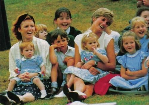 Sarah holding Eugenie and Beatrice on Diana's lap at Harry's 7th birthday party