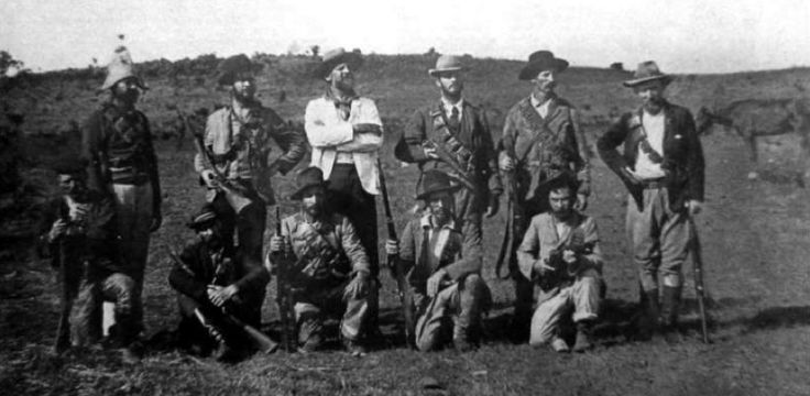 The plight of the Boers caused much international condemnation of the British, and numerous foreign volunteers came to the aid of the embattled Republics. Above, pictured during the Siege of Ladysmith, are members of the Irish Brigade, which was composed of Irish and Irish-Americans, many of them miners who already had been working in the region. Standing in the center wearing the white is Col. JYF Blake, the commander of the Brigade, and an ex-US Army officer. (McGregor Museum)