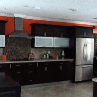 Orange accent wall what we are doing in are kitchen our wall