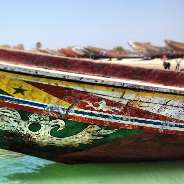Close up colourful Fishing boats in the Gambia, Africa