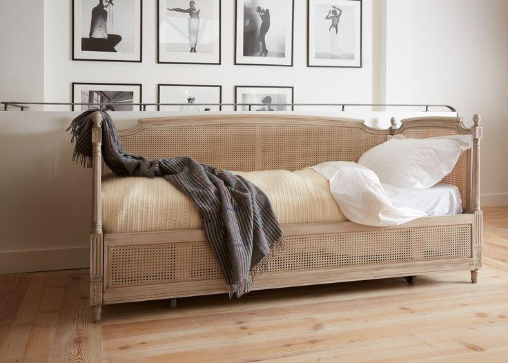 Our range of sofa/pull-out beds includes the Trianon, inspired by designs from the Louis XVI period, featuring hand carved details and a caned back and sides. A simple mechanism converts this elegant sofa into a double bed, perfect for overnight guests, with an extra deep mattress ensuring a good night's sleep #luxurybeds #sofabeds simonhorn.com
