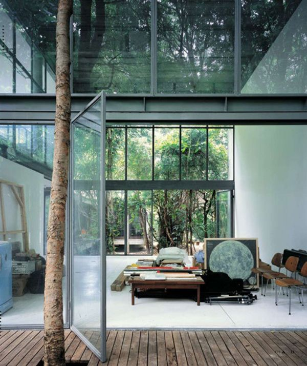 I would love to have an art studio like this, a whole bunch of window walls. :)