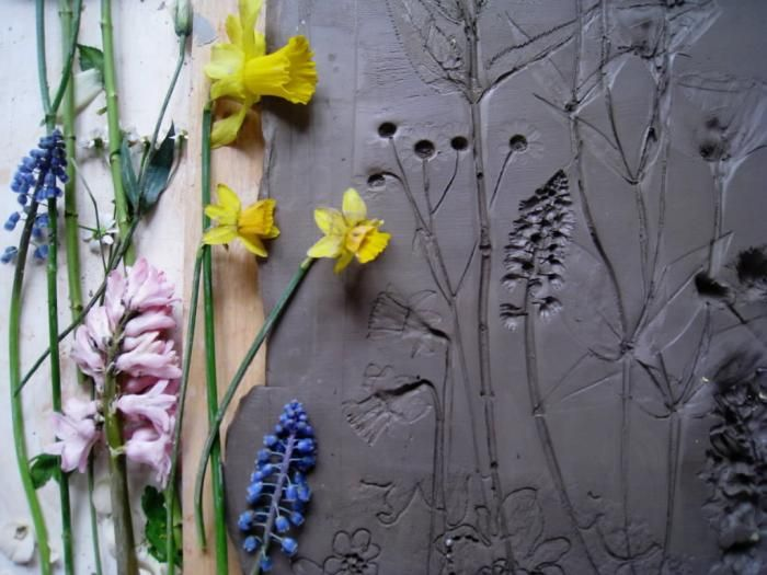 "A friend in London called our attention to the work of Rachel Dein, an artist and theater prop maker who specializes in preserving the ghost impressions of flowers and objects in quadrants of plaster. She describes her results as ""fossils from everyday life."" Above: After creating the desired impressions, Dein hammers and seals a wooden frame onto the clay and pours plaster over it."