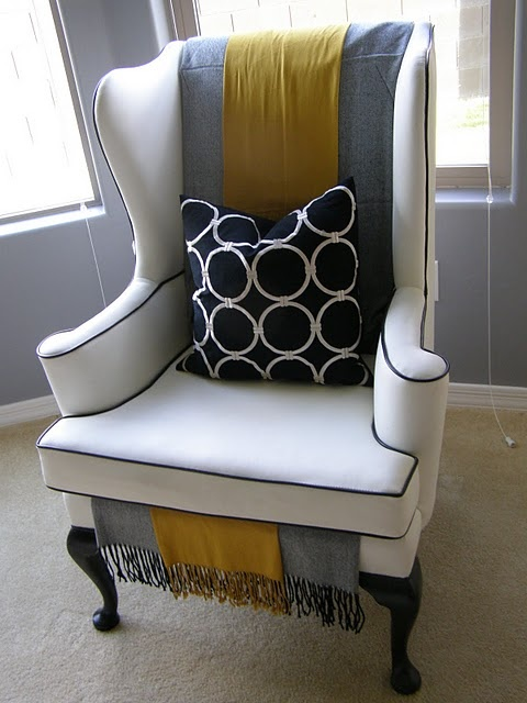 Wing back chair. Showing you how you can dress it right, and with any colors.  Remember too with a basic shade such as grey, you may change to fit it in with any changes in room coloring changes.