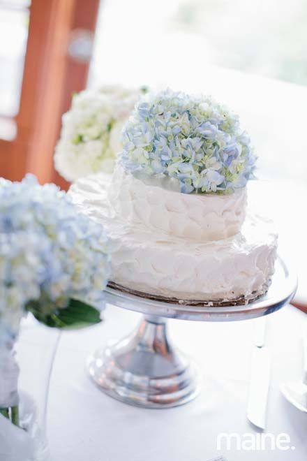 Wedding cake idea - simple, light blue hydrangea, textured rustic butter cream frosting