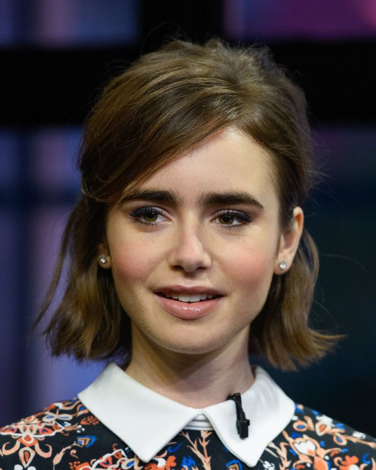 Lily Collins's tousled lob is proof that you can look cute while growing out bangs and a bob.