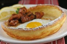 Dutch Baby pancakes with embedded eggs and chorizo. Holy mother of all that is delicious.
