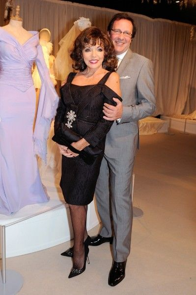 Joan Collins attended The Iconic Wedding Dress Exhibition with her husband, Percy Gibson. She is pictured here with her stunning wedding gow...