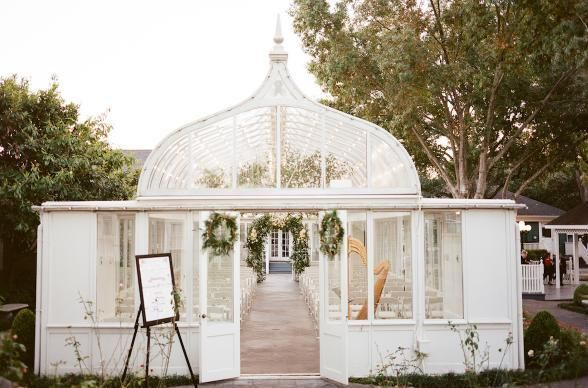 The spots for I-do's in Houston include the beautiful greenhouse & garden, The Garden of River Oaks wedding venue. Photo by Archetype Photo