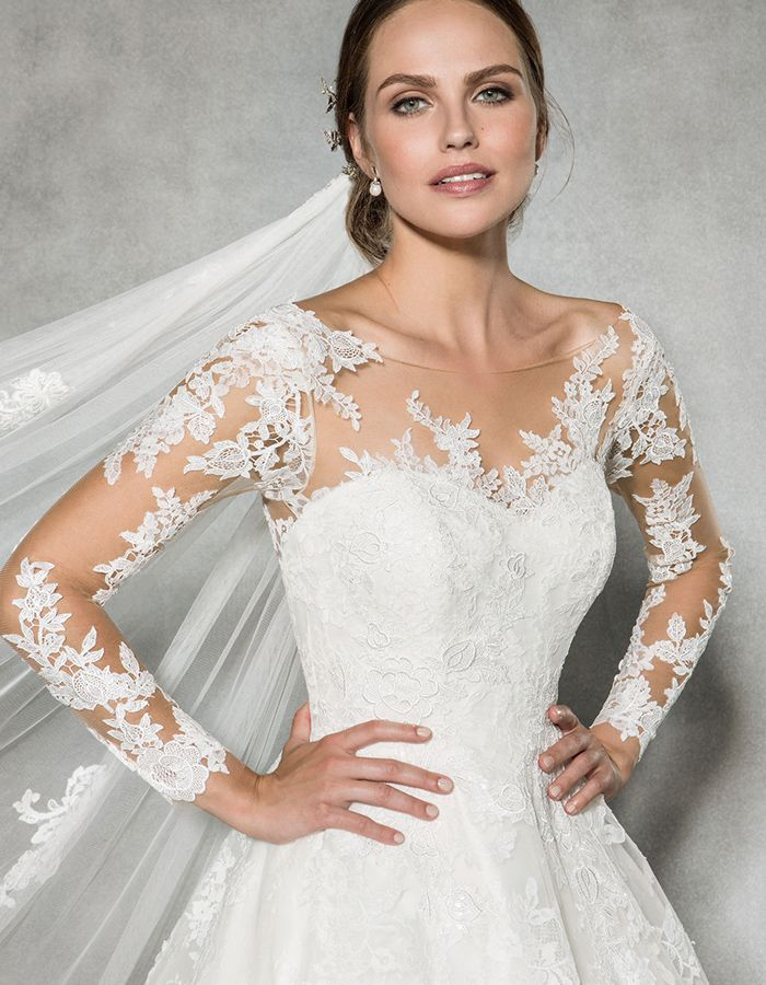 The beautiful 'Leah' by Anna Sorrano ✨This lace sleeved wedding dress is simply stunning ✨ Could this illusion neckline dress be 'the one' for you? www.wed2b.co.uk