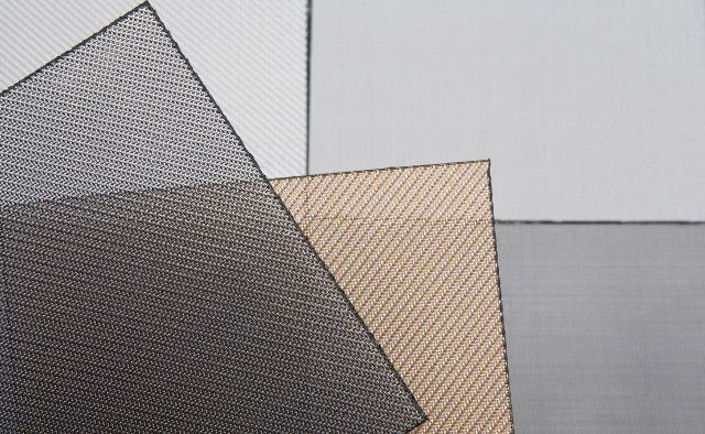Sefar Architecture Vision is an open weave fabric finely woven from black PET (polyester) fibres and coated on one side with a thin layer of metal.