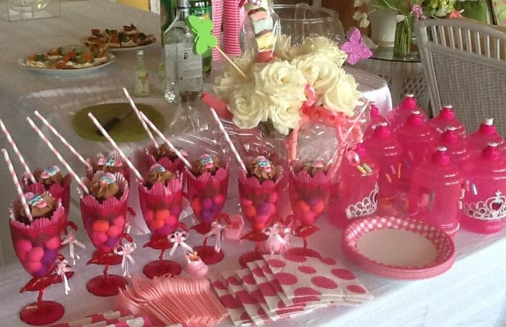 Candies & cupcakes in wine glasses & Decorated water jugs