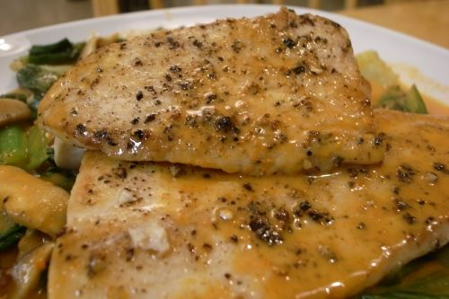 Foil baked mahi mahi. Olive oil.  Top with scallions, tsp. of white wine or cider, salt, pepper, pat of butter.  Lemon wedge if desired.  wrap in foil, bake 25 mins at 400 degrees.