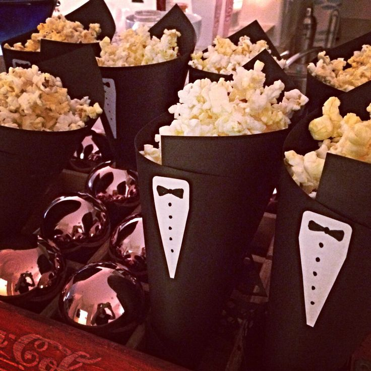 DIY Tuxedo popcorn cones for Oscar themed party. Black paper, sharpie, and white labels.