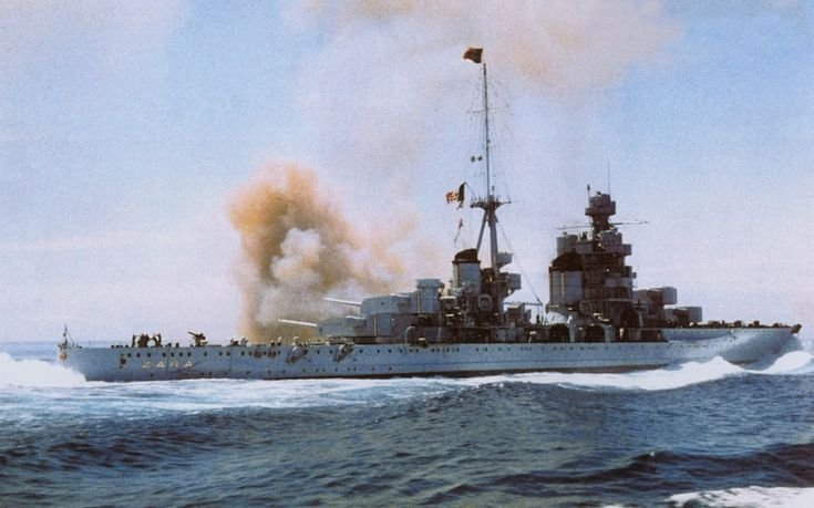 """Italian heavy cruiser """"Zara"""" commences fire with her main guns somewhere in the Mediterranean, probably 1942."""