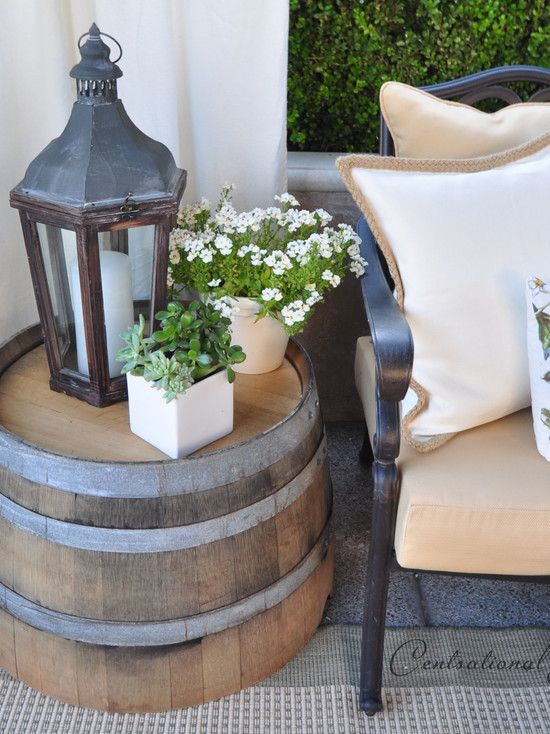 Upturned barrel doubles as side table for porch