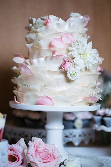 Rose petal wedding cake delicate wedding cake in ivory and blush pink at River Highlands Ranch photo by Andrew & Melanie Photography