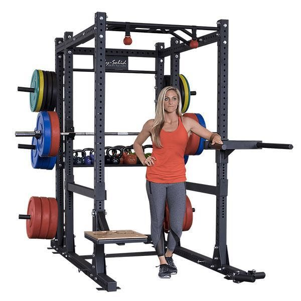 """Body-Solid's new full commercial power rack package, the SPR1000BackP4, features everything you want on a power rack today, with all the attachments to make a complete gym.  The 3"""" x 3"""" 11-gauge steel mainframe gives this rack a 1000 lb weight capacity, meaning it'll hold up even through the most strenuous of workouts.  The SPR1000BackP4 is 90"""" tall which is perfect for chin-ups, standing shoulder presses and many other exercises that are compromised on shorter, competitive power racks."""