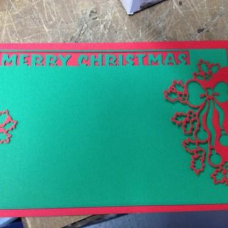two piece Christmas card on the laser cutter
