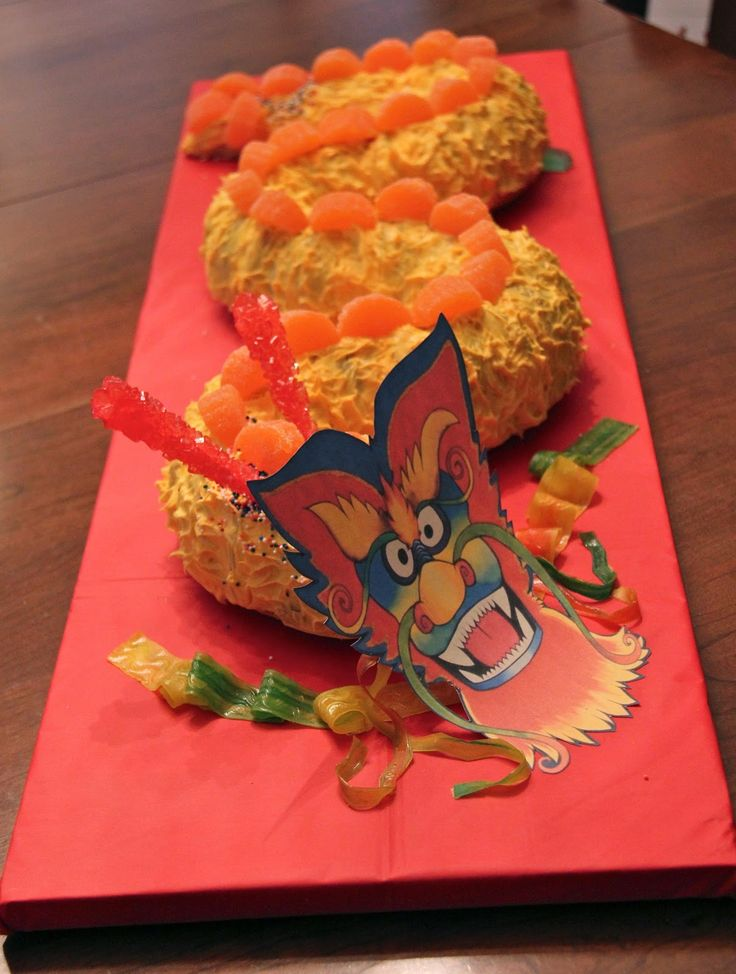 A Chinese New Year Cake - My Overthinking.  GREAT idea to use orange slices as scales, but not so nice looking face/head :/